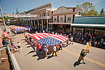 Italian Benevolent Society's 129th Annual Italian Picnic Parade, Main Street, Sutter Creek, Calif...Native Sons of the Golden West march with two large U.S. Flags stretched between the marchers.