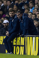 12.12.2013 London, England. Tottenham Hotspur manager André Villas Boas discusses with his staff during the Europa League game between Tottenham Hotspur and Anzhi Makhachkala from White Hart Lane.