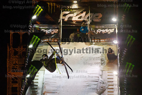 Kai Mahler from Switzerland performs his trick during the freestyle skiing competition held on the 35 meters high artificial ski jumping ramp on the Monster Energy Fridge Festival in central Budapest, Hungary on November 12, 2011. ATTILA VOLGYI