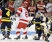 Jordan Heywood (Merrimack - 4), Joe Pereira (BU - 6) and Joe Cannata (Merrimack - 35) keep an eye on the airborne puck. - The visiting Merrimack College Warriors tied the Boston University Terriers 1-1 on Friday, November 12, 2010, at Agganis Arena in Boston, Massachusetts.