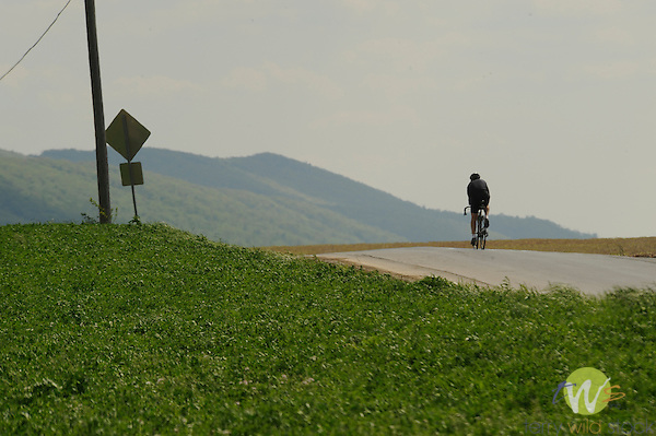 Cyclist on country road in Spring. Kishacoquillas Valley, PA.