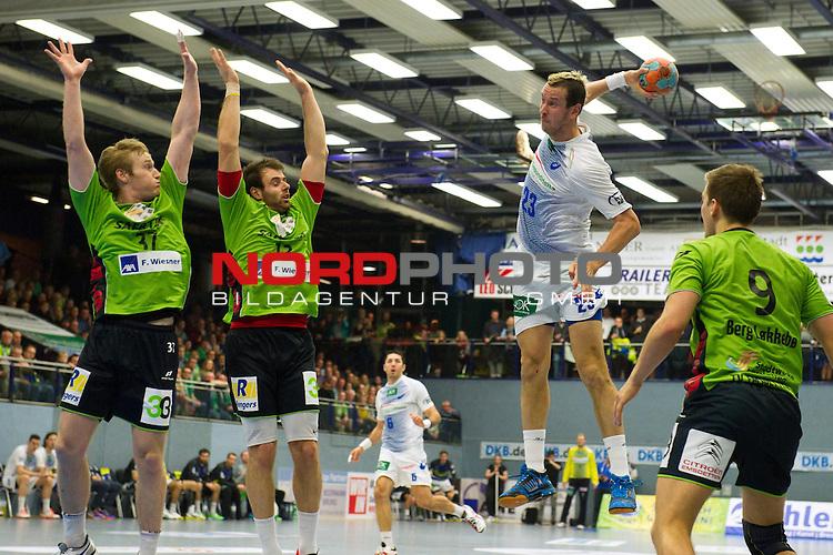 07.12.2013, Emshalle, Emsdetten,  Handball, Bundesliga, TV Emsdetten vs. HSV Handball<br />  <br /> <br /> Torwurf Pascal Hens (#23 Hamburg) gegen Block / Abwehr von Ernir Arnarson (#37 Emsdetten), Faruk Halilbegovic (#13 Emsdetten), Steffen Berg L&oslash;kkeb&oslash; / Lokkebo (#9 Emsdetten)<br /> <br />   Foto &copy; nordphoto / Kurth