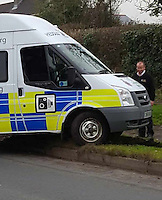 "COPY BY TOM BEDFORD<br /> Pictured: The speed camera van that got stuck on a grass verge in the village of Laleston, Bridgend, Wales, UK.<br /> Re: A speed camera van that got itself firmly wedged on top of a roadside verge had to be towed free by police – much to the amusement of a passing motorist.<br /> The comical scene was captured on camera by a driver from Bridgend.<br /> He was passing through the village of Laleston, Bridgend when he saw the Ford Transit, in the livery of the GoSafe partnership, in a bit of a pickle.<br /> ""I think they must have tried to get onto the old concrete slab which I think was an old bus stop,"" said the man, who did not wish to be named.<br /> ""But I think he tried to go over the high curb and got stuck."""