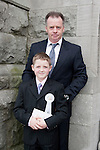 Mark Wilton who made his First Communion at St. Mary's Church on Saturday 16th May, pictured with his father.