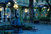 Early morning sun lights Pioneer Square Park's Pergola and the bust of Chief Sealth, in downtown Seattle, Washington.