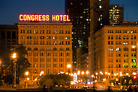 The Congress Hotel is lit by street and city night light on Michigan Avenue in Chicago, Illinois