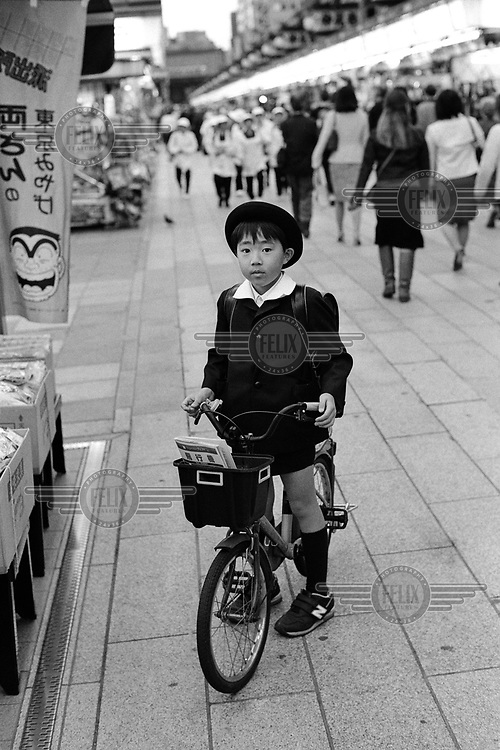 Schoolboy with his bike buying snacks on his way home from school.