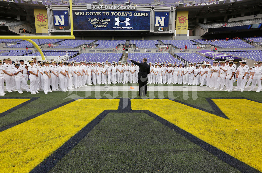 Navy cadets in the choir rehears before Saturday's NCAA Division I football game between the Ohio State Buckeyes and the Navy Midshipmen at M&T Bank Stadium in Baltimore on August 30, 2014. (Dispatch Photo by Barbara J. Perenic)