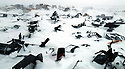 WINNER NEWS FEATURES. PRESS PHOTOGRAPHER'S YEAR 2006 ..A ski-doo 'graveyard' on the outskirts of the arctic village of Ivujivik, Canadian province of Nunavik.....The Inuits have largely abandoned dog sleds as their main form of transport in favour of motorised snow mobiles which are not recyclable and which ironically contribute to global warming...As the sea ice thins accidents are becoming more common as ski-doos have no inate ability to sense danger in the way that the dogs teams did...