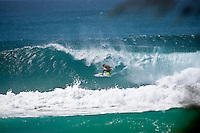 MICK FANNING  (AUS) surfing the swell generated by Cyclone Jasper at the Superbank, Coolangatta , Queensland, Australia.  Photo: joliphotos.com