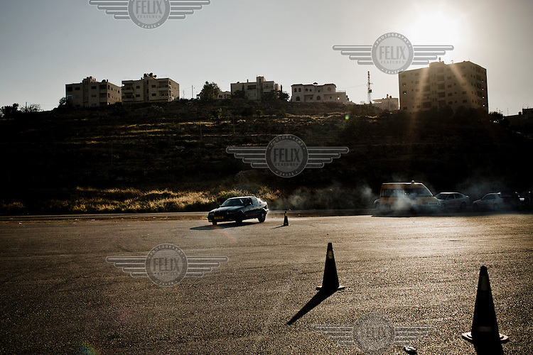 The 'Speed Sisters' practice and race around an abandoned piece of land on the outskirts of Ramallah.