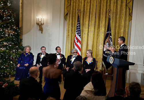 United States President Barack Obama (R) claps for actress Barbara Cook (L), singer Neil Diamond (2L), musician Yo-Yo Ma (3L), musician Sonny Rollins (3R) and actress Meryl Streep during a Kennedy Center Honors reception in the East Room of the White House, Sunday, December 4, 2011 in Washington, DC.  For their accomplishments and contributions to the arts actress Meryl Streep, singer Neil Diamond, actress Barbara Cook, musician Yo-Yo Ma, and musician Sonny Rollins where etched recognized as this year's recipients of the Kennedy Center Honors..Credit: Brendan Smialowski / Pool via CNP