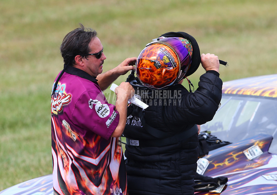 Aug. 31, 2013; Clermont, IN, USA: NHRA pro mod driver Mike Knowles with a crew member during qualifying for the US Nationals at Lucas Oil Raceway. Mandatory Credit: Mark J. Rebilas-