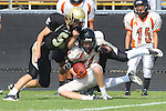 Palos Verdes, CA 09/22/11 - unknown Beverly Hills player(s), Max MacLeay (Peninsula #5) and Marco Catallo (Peninsula #10)) in action during the Beverly Hills-Peninsula Varsitty Football gane.) in action during the Beverly Hills-Peninsula Varsitty Football gane.