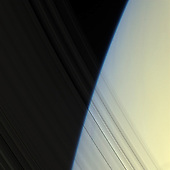 Pasadena, CA - March 13, 2009 -- The Cassini spacecraft peers through Saturn's delicate, translucent inner C ring to see the diffuse blue limb of Saturn's atmosphere.  This view looks toward the unilluminated side of the rings from about 20 degrees above the ringplane. Images taken using red, green and blue spectral filters were combined to create this natural color view. The images were obtained with the Cassini spacecraft narrow-angle camera on April 25, 2008 at a distance of approximately 1.5 million kilometers (930,000 miles) from Saturn. Image scale is 8 kilometers (5 miles) per pixel. Image scale is 8 kilometers (5 miles) per pixel..Credit: NASA-JPL-Space Science Institute via CNP