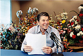 United States President Ronald Reagan makes his weekly radio address to the nation from Bethesda Naval Medical Center on Saturday, July 20, 1985.  Behind him are balloons and flowers from well-wishers..Mandatory Credit: Pete Souza - White House via CNP