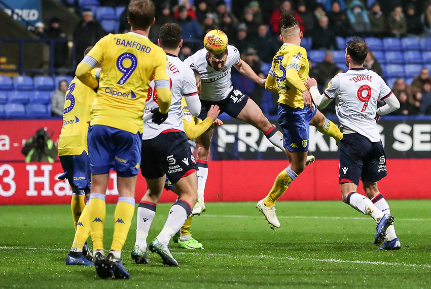 Bolton Wanderers' Jack Hobbs heads at goal <br /> <br /> Photographer Andrew Kearns/CameraSport<br /> <br /> The EFL Sky Bet Championship - Bolton Wanderers v Leeds United - Saturday 15th December 2018 - University of Bolton Stadium - Bolton<br /> <br /> World Copyright © 2018 CameraSport. All rights reserved. 43 Linden Ave. Countesthorpe. Leicester. England. LE8 5PG - Tel: +44 (0) 116 277 4147 - admin@camerasport.com - www.camerasport.com