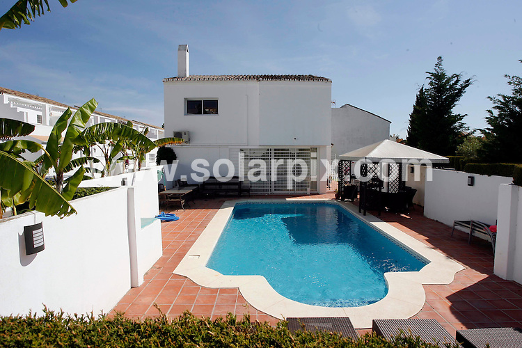 **ALL ROUND PICTURES FROM SOLARPIX.COM**.**WORLDWIDE SYNDICATION RIGHTS**.Pictures show Daniel and Christopher Kinahan (aka Christy) owned properties. The father and son were alleged to be the leaders of a large criminal gang operating along the Costa del Sol, and were amongst those arrested in dawn raids this morning. Estepona, Malaga, Spain. 25 May 2010.Full story by Tom Worden (Tag News Media) +34 680 152 448..This pic: Daniel Kinahan owned property (no 43, the Senorio de Cortes urbanisation) where arrests were made in a dawn raid this morning by more than 20 spanish police..JOB REF: 11312 AB1 DATE: 25_05_2010.**MUST CREDIT SOLARPIX.COM OR DOUBLE FEE WILL BE CHARGED**.**MUST AGREE FEE BEFORE ONLINE USAGE**.**CALL US ON: +34 952 811 768 or LOW RATE FROM UK 0844 617 7637**