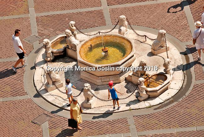 Piazza Vecchia and a view of the central fountain in Bergamo, Italy