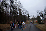 People head back to their cars after witnessing Punxsutawney Phil predict the weather at Gobbler's Knob in Punxsutawney, Pennsylvania February 2, 2012.