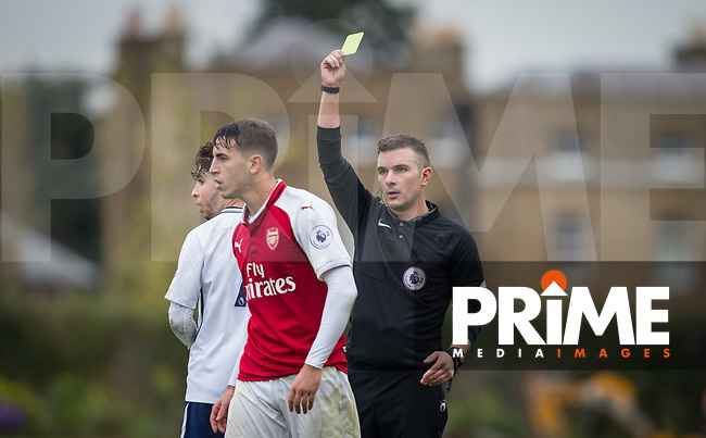 Referee Savvas Yianni shows Julio Pleguezuelo of Arsenal a yellow card during the EPL2 - U23 - Premier League 2 match between Spurs U21 and Arsenal at Tottenham Hotspur Training Ground, Hotspur Way, England on 23 October 2017. Photo by Andy Rowland.