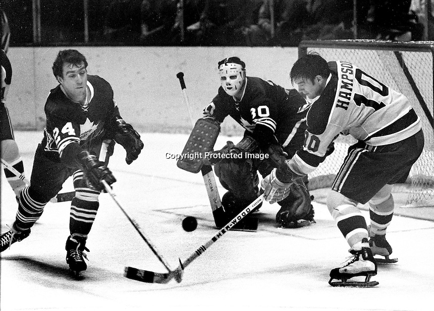 California Golden Seals Ted Hampson tries to score against Toronto Maple leafs #24 Bruce Gamble and goalie #30...(1970 photo/Ron Riesterer)