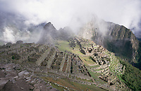 Machu Picchu from near the Dawn Gate and partly obscured by cloud.