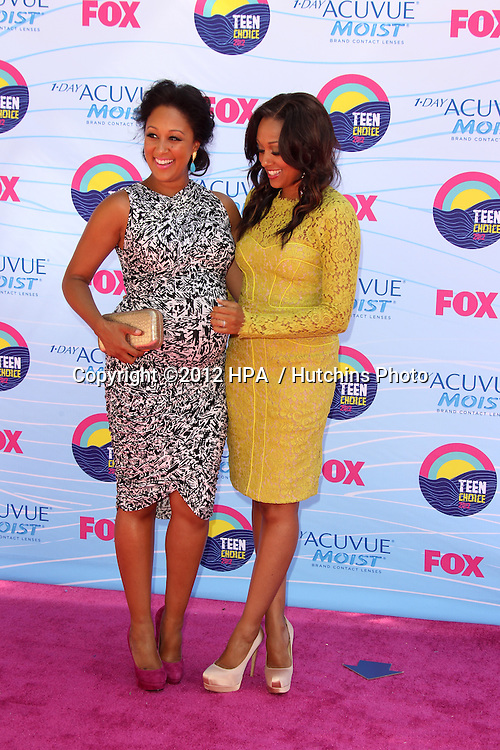 LOS ANGELES - JUL 22:  Tamera Mowry, Tia Mowry arriving at the 2012 Teen Choice Awards at Gibson Ampitheatre on July 22, 2012 in Los Angeles, CA