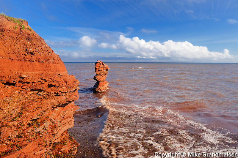 Flowerpot, cliffs of red soil and clouds looking at Gulf of St. Lawrence