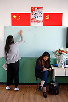 Lhasa, Tibet, China - Tibetan educator Deqingyuzhen (R) monitors the quality of a lesson at a private school in Lhasa, September 2018.