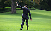 United States President Barack Obama waves to a crowd on the South Lawn of the White House as he walks to Marine One for a trip to Missouri and Texas on October 4, 2011. .Credit: Dennis Brack / Pool via CNP