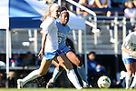 19 October 2014: North Carolina's Amber Munerlyn (8) and Duke's Kara Wilson (left). The Duke University Blue Devils hosted the University of North Carolina Tar Heels at Koskinen Stadium in Durham, North Carolina in a 2014 NCAA Division I Women's Soccer match. North Carolina won the game 3-0.