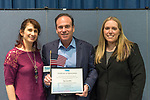 Wyandanch, New York, USA. March 26, 2017. At center, JAY JACOBS, Chairman of Nassau County Democratic Committee, holds Certificate of Appreciation and American Flag presented by, (L) BETH MEHRTENS McMANUS, and (R) SUE MOLLER, two administrators of Together We Will Long Island. Jacobs spoke at Politics 101 event, the first of a series of activist training workshops for members of TWW LI, the L.I. affilitate of TWW.