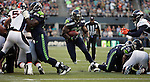 Seattle Seahawks running back Robert Turbin  runs against the Denver Broncos at CenturyLink Field in Seattle, Washington on  August 17, 2013. The Seattle Seahawks beat the Broncos 40-10.     ©2013. Jim Bryant Photo. All Rights Reserved.