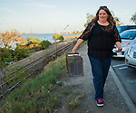 Susan Smith of Rivertown Cats and H.A.R.P. (Homeless Animal Response Program) carries an empty trap in Antioch, California on Saturday, March 22, 2014.  Photo/Victoria Sheridan