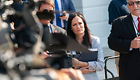 White House Press Secretary Stephanie Grisham listens as United States President Donald J. Trump speaks to the media at the White House  August 7, 2019 before departing to visit El Paso, TX and Dayton Ohio after recent shootings in those cities. <br /> CAP/MPI/RS<br /> ©RS/MPI/Capital Pictures
