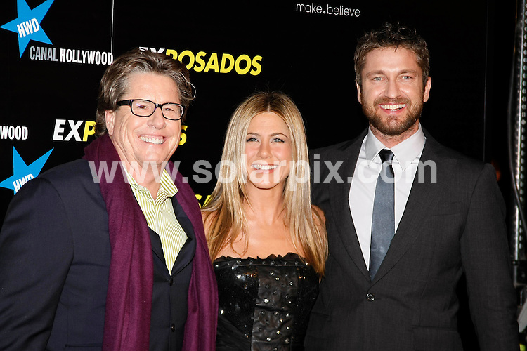 **ALL ROUND PICTURES FROM SOLARPIX.COM**.**UK SYNDICATION RIGHTS ONLY**.Arrivals for the gala screening of the new film The Bounty Hunter aka Exposados in Spanish. Madrid, Spain. 30 March 2010...This pic: Director Andy Tennant, Jennifer Aniston and Gerard Butler..JOB REF: 11015 SKX      DATE:  30_03_2010.**MUST CREDIT SOLARPIX.COM OR DOUBLE FEE WILL BE CHARGED**.**MUST NOTIFY SOLARPIX OF ONLINE USAGE**.**CALL US ON: +34 952 811 768 or LOW RATE FROM UK 0844 617 7637**