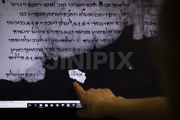 "Imaging technician and camera operator, Shay Halevy, shows on screen fragments of a newly discovered script found by Israel Antiquities Authority researcher, Oren Abelman, in ""Cave 11"" near Qumran, at the IAA department in the Israel Museum, Jerusalem, on May 2, 2018. The fragments are now readable through advanced imaging equipment which can reveal letters that are invisible to the naked eye, at the Dead Sea Scrolls' conservation labs of the authority. Photo by: JINIPIX"