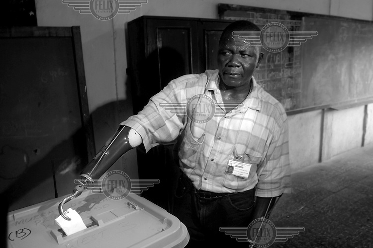 A man casts his vote at a school in Freetown. Elections held six months after end of the civil war passed peacefully. The man was one of many victims of the brutal rebel movement RUF.Sierra Leone