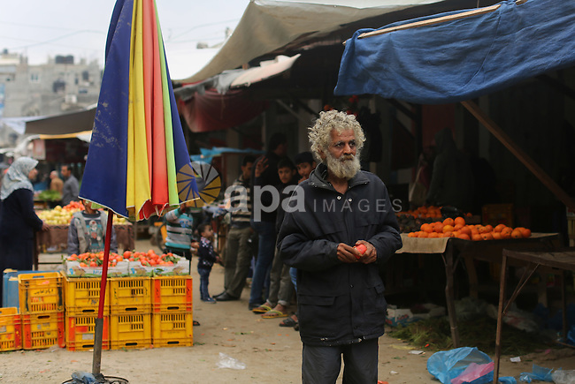A Palestinian man walks at the market in Shati refugee camp in Gaza city on Jan. 07, 2016. Photo by Ezz al-Zanoun