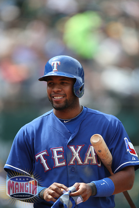 OAKLAND, CA - MAY 15:  Elvis Andrus #1 of the Texas Rangers walks back to the dugout during the game against the Oakland Athletics at O.co Coliseum on Wednesday May 15, 2013 in Oakland, California. Photo by Brad Mangin