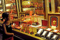 A young girl looks at gold items outside a gold shop, Chengdu, China. Since gold's retail price is keep increasing, many people purchase it as an investment..17 Jul 2010 ...