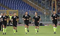 Calcio, Serie A: Roma-Catania. Roma, stadio Olimpico, 26 agosto 2012..Referee Andrea De Marco, center, warms up with assistant referees Maurizio Viazzi, left, and Maurizio Liberti, right, and added referees Davide Massa, second from left, and Aleandro Di Paolo, second from right, prior to the start of the Italian Serie A football match between AS Roma and Catania, at Rome, Olympic stadium, 26 August 2012. .UPDATE IMAGES PRESS/Riccardo De Luca