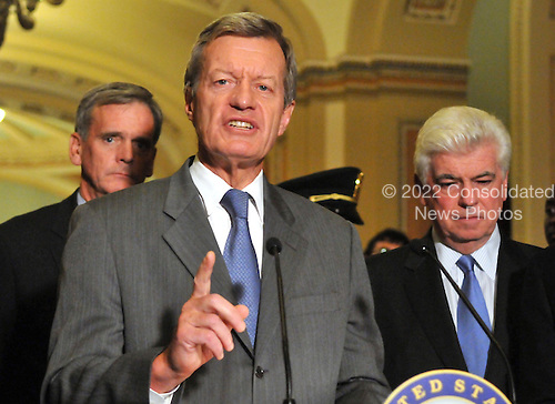 Washington, DC - October 1, 2008 -- United States Senator Max Baucus (Democrat of Montana), center, makes a statement to reporters outside the United States Senate Chamber in the United States Capitol after casting votes to pass the 700 billion dollar Wall Street bail-out package in Washington, D.C. on Wednesday, October 1, 2008. From left to right: United States Senator Judd Gregg (Republican of New Hampshire, left, and United States Senator Chris Dodd (Democrat of Connecticut), right, listen in..Credit: Ron Sachs / CNP.(RESTRICTION: NO New York or New Jersey Newspapers or newspapers within a 75 mile radius of New York City)