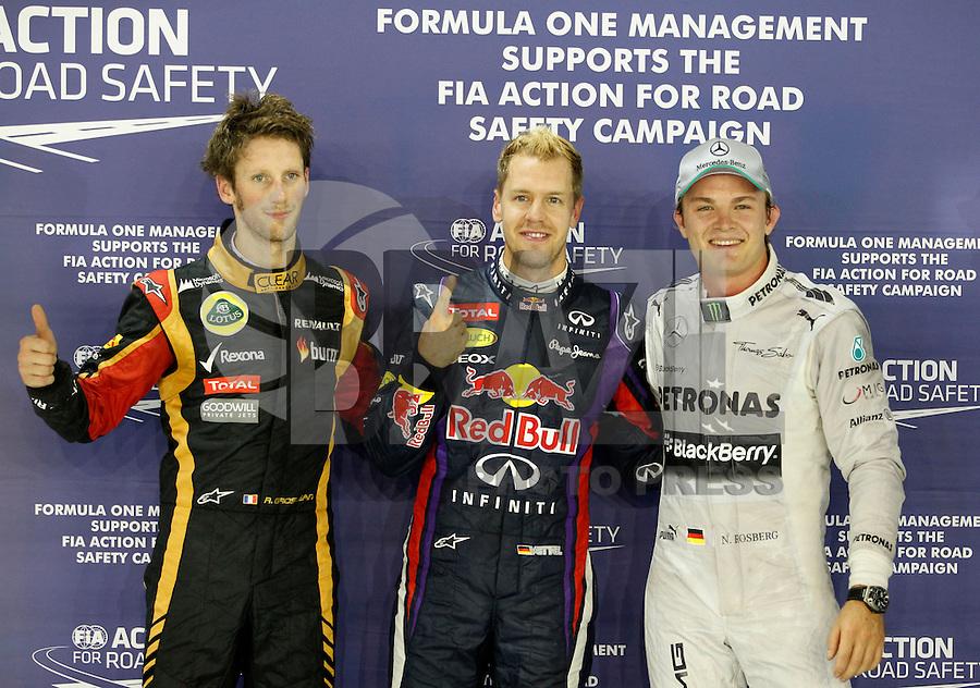 CINGAPURA, 21.09.2013 - F1 GP SINGAPURA - O piloto alemao Sebastian Vettel da equipe Red Bull celebra a conquista neste sabado da pole position para o GP de Cingapura que acontece amanha em Cingapura. (Foto: Pixathlon / Brazil Photo Press).