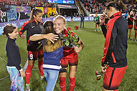 Portland, Oregon - Sunday September 11, 2016: Portland Thorns FC midfielder Dagny Brynjarsdottir (11) receives roses during a regular season National Women's Soccer League (NWSL) match at Providence Park.