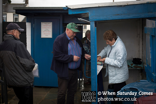 Clitheroe 0 Consett 1, 20/08/2016. Shawbridge, Northern Premier League Division One North. A programme seller serving spectators inside the ground before Clitheroe played Consett at Shawbridge in an FA Cup preliminary round tie. Northern Premier League division one north team Clitheroe were formed in 1877 and have played at the same ground since 1925. Visitors Consett, from the Northern League division one, won the match 1-0, watched by 207 spectators. Photo by Colin McPherson.