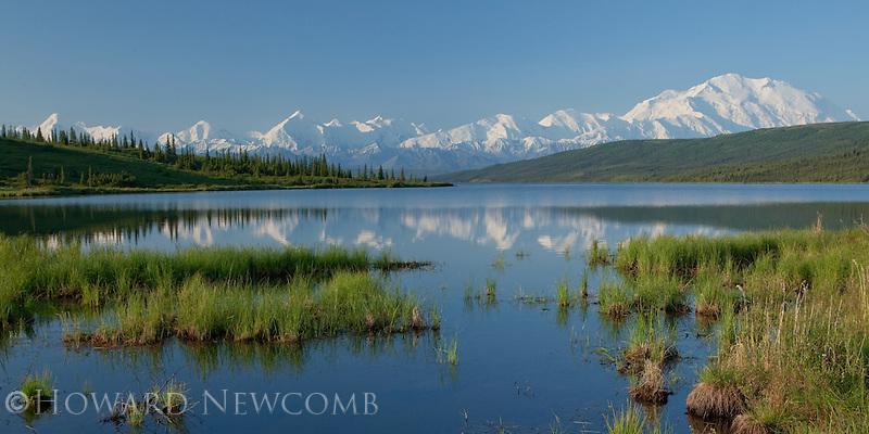 Mt. McKinley and the Alaska Range reflecting on a calm summer morning at Wonder Lake, Denali National Park, Alaska.