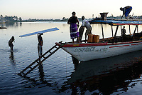 MADAGASCAR, Mananjary, canal des Pangalanes, evening at boat jetty / MADAGASKAR Mananjary, abends am Bootsableger, von hier werden Waren in die Doerfer am canal des Pangalanes verschifft