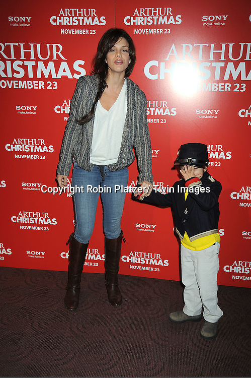 "Vanessa Ferlito and son Vince posing for photographers at The New York Special Screening of ""Arthur Christmas"" on November 13, 2011 at The Clearview Chelsea Theatre in New York City."